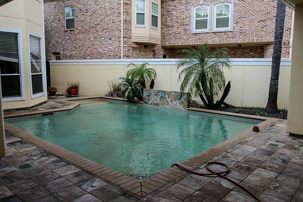 Private pool in the fenced front yard. (photo 4)