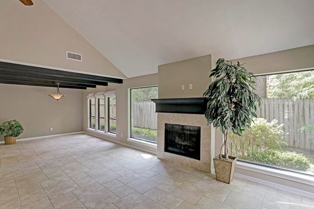 The foyer flows into the open living room and formal dining room. (photo 4)