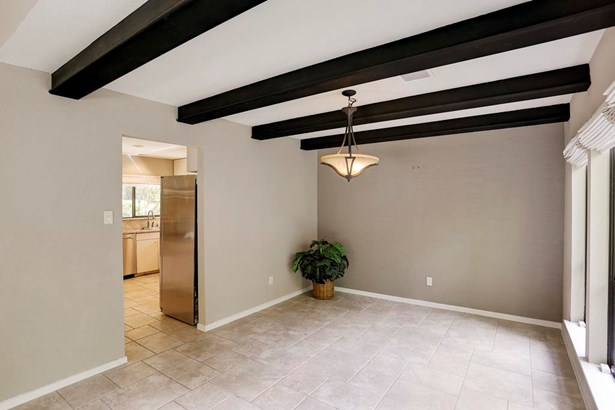 The formal dining room is connected to the kitchen and living room. Plenty of natural lighting is found throughout the entire home. (photo 5)
