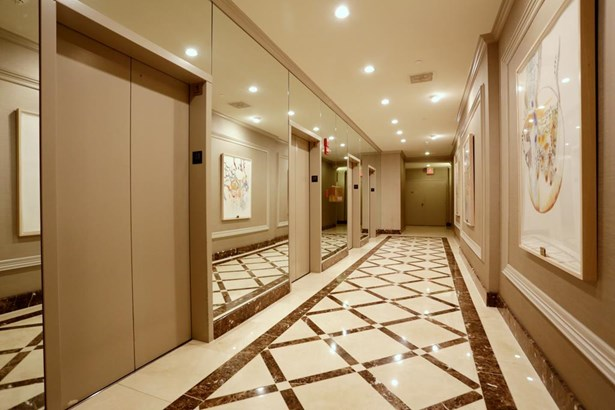 The elevators will take you to your new home. (photo 3)