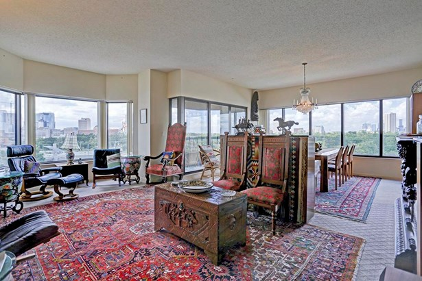 This spacious living and dining space could be yours to refashion to your needs. (photo 5)