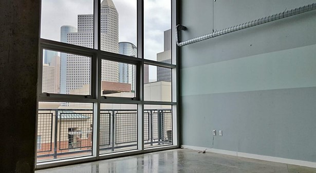 Located in the heart of midtown with great restaurants and night life spots, this loft condo offers a wall of windows with a sky scraper view, (photo 1)