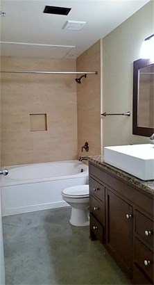 In the entry is access to a full bath with garden tub/shower. (photo 3)
