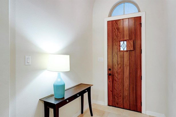 Upon entry you are greeted by a foyer area with neutral paint tones carried throughout the home. Above the front door is a rounded crescent window allowing privacy and light for the space. (photo 4)