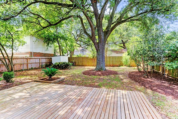 Gorgeous and spacious backyard with recent decking (2016), manicured landscaping, and a must see, breath-taking mature LIVE OAK TREE sprawling across the entire backyard for shades and cool for Houston s hot & spicy summer months! (photo 3)