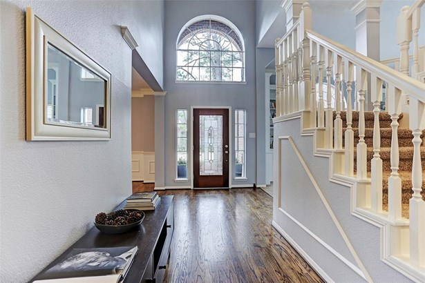 Inviting light filled entry with rich hardwood floors. (photo 2)