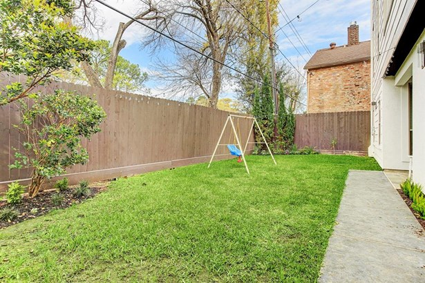 Enter the gate into this nicely landscaped yard with bistro lights. Great for play and for entertaining. (photo 2)