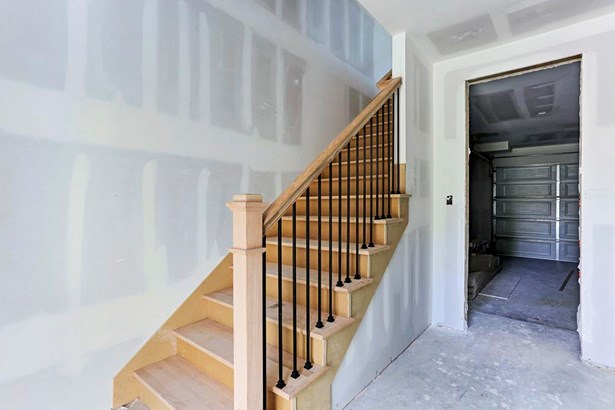 The homes of Stuart Hutchins villas feature oversized 2 car garages and beautifully crafted wood staircases.Construction as of 6/27/17. (photo 3)