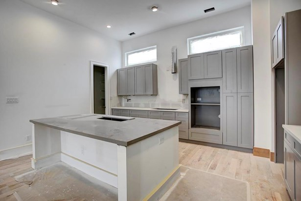The kitchen will offer a large island and be open to the rest of the 2nd floor. Wood flooring, soaring ceilings, large windows. This homes are sure to impress. Construction as of 6/27/17 (photo 5)