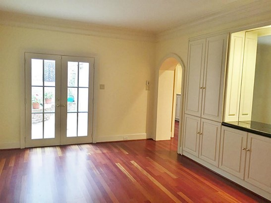 View of DIning Room with doors to private patio. Note built-in cabinetry for all your fine china storage. (photo 3)