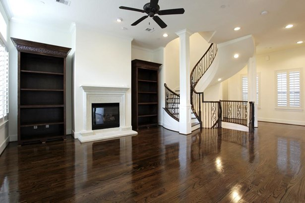 Living room with cozy fire place and gorgeous hardwood floors. (photo 5)