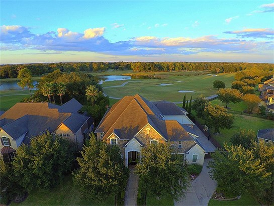 An aerial of the front of this fabulous meticulously maintained property with views of golf course and lake. (photo 2)