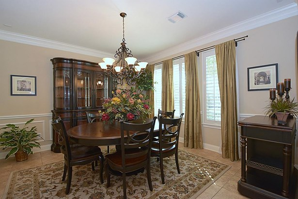 Elegant Formal Dining Room has plenty of room for table and chairs, China Cabinet and Sideboard. Plantation Shutters, Draperies, 6-Arm Chandelier. Designer Paint, Crown Mould, Chair Rail. (photo 3)
