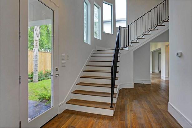 "Stunning Foyer with 5"" white oak hardwood floors and custom wrought iron stair railing (photo 3)"