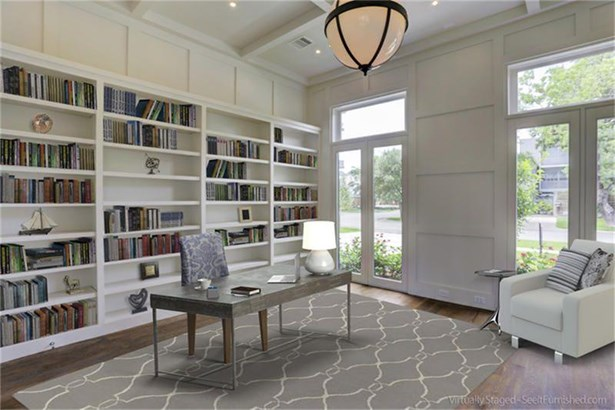 Double door entry Study with floor to ceiling built in bookcases and French doors overlooking front yard (photo 4)