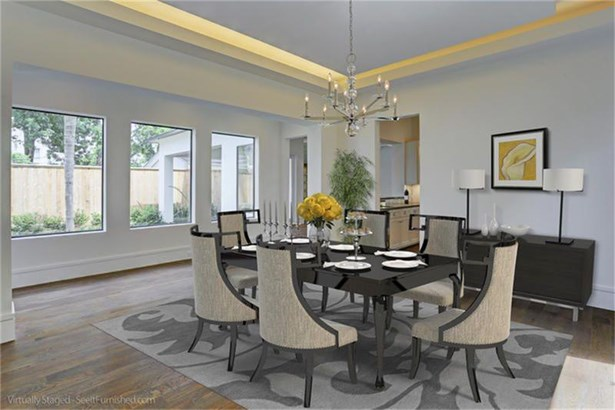 Formal Dining features a suspended cove ceiling with LED lighting and views of courtyard (photo 5)