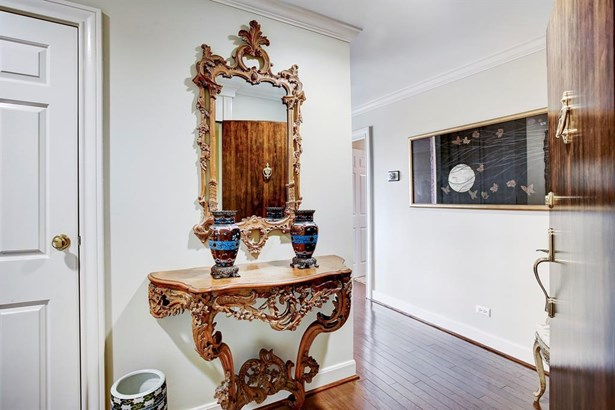The Entry brings you into this sunny, beautifully updated home. To the left is a cloak closet. (photo 2)