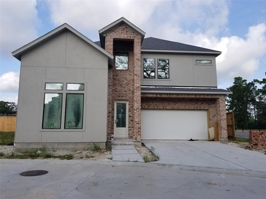 Plan B in the Lacey Oaks community offers 2704 sf (per builder), 3 bedrooms/3 baths, 1st level study (or 4th bedroom) + game room. Formal dining room, wood floors in living/dining/kitchen, and spacious living room with fireplace and access to the rear cov (photo 3)