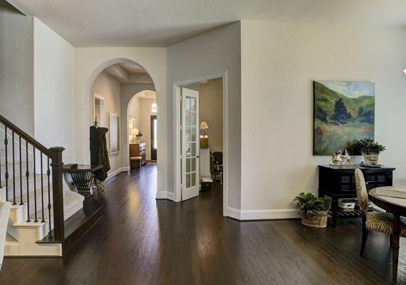 Beautiful entry archways, hard wood floors, tall ceilings, 4 bedrooms downstairs with an upstairs game room. (photo 3)