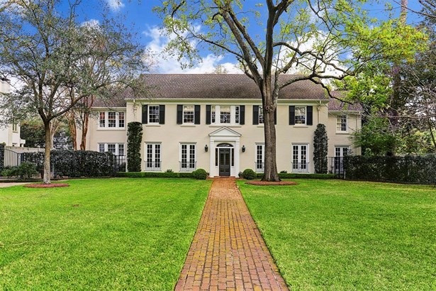 This stately Georgian style brick house on its large River Oaks lot provides a wonderful opportunity to own one of the areas great houses. It was built 1939 and expanded and remodelled subsequently by noted architects Hamilton Brown and Robert Singleton. (photo 1)