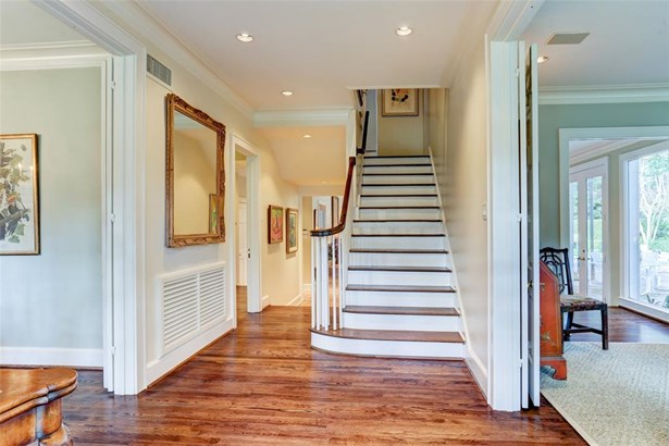 Entry with formal living to right and dining to left. The stairs lead to 5+ upstairs bedrooms and the halls lead to the gracious sunny family room. (photo 3)