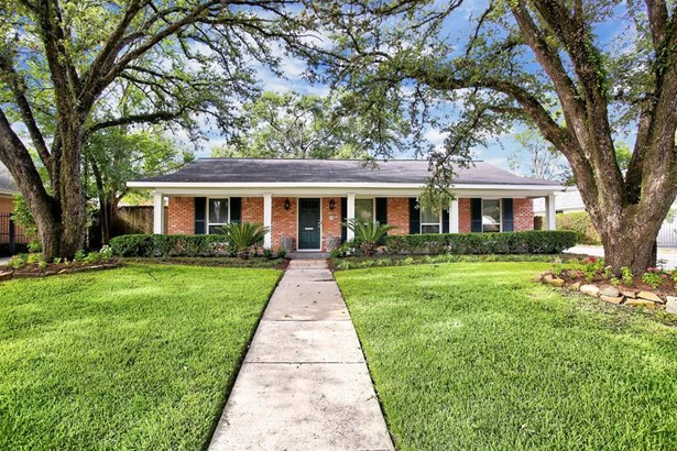 Tucked away in the section of Briarbend closest to the Park is this gorgeously expanded and renovated home on a large, shady lot. (photo 1)