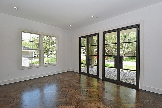 Formal Living Room has white oak stained herringbone pattern flooring. two sets of Custom Steel Doors opening to Front Covered Porch. (photo 4)