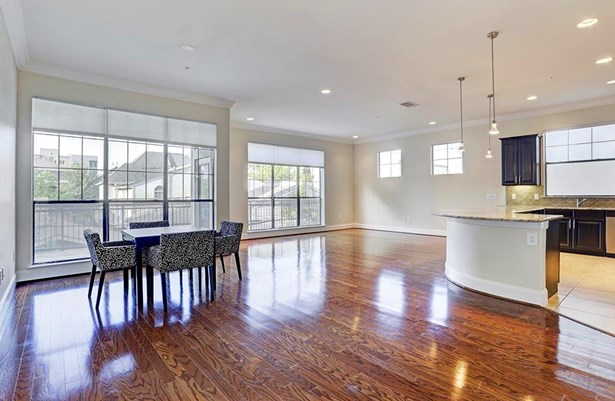 Gorgeous light-filled open floor plan with beautiful hardwoods. (photo 1)