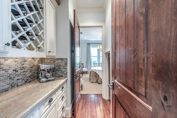 Dry bar and butlers pantry with under stair storage closet. (photo 4)
