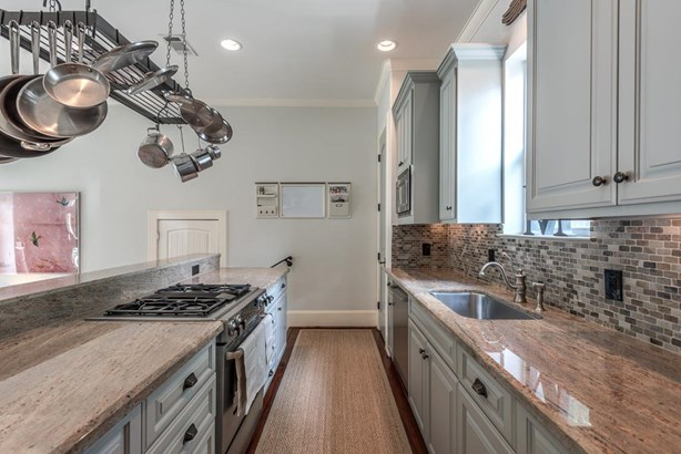 Great kitchen with lot s of natural light, pot rack, range top, dishwasher, pantry and oversized sink. (photo 5)