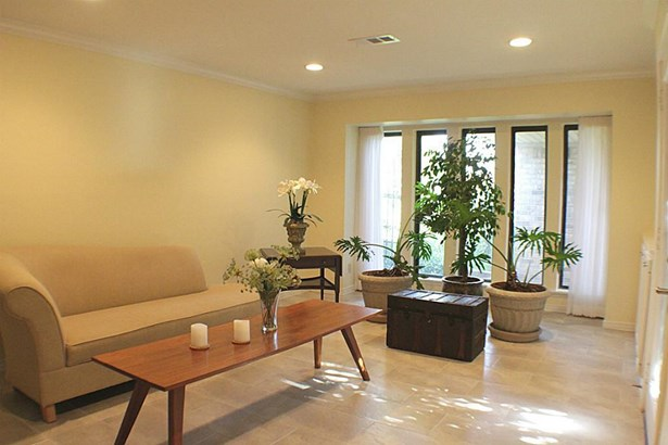 Upon entering, the formal living room invites you in with natural light & clean lines. (photo 3)