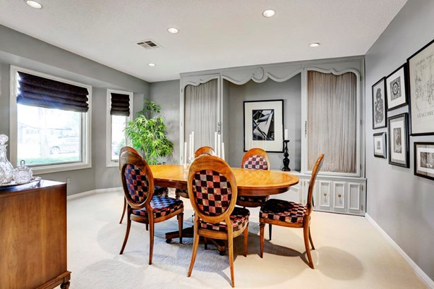 Large dining room with beautiful curved window. The beautiful storage piece is not attached so it will remain or can be removed (photo 3)