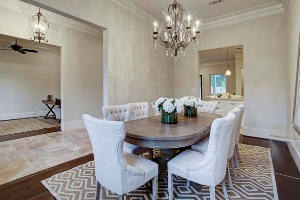 Entertain with ease - spacious dining room located at the front of the home with wonderful views of the front yard. Wine closet/bar area easily accessible from the dining and makes for a fabulous entertaining flow. (photo 4)