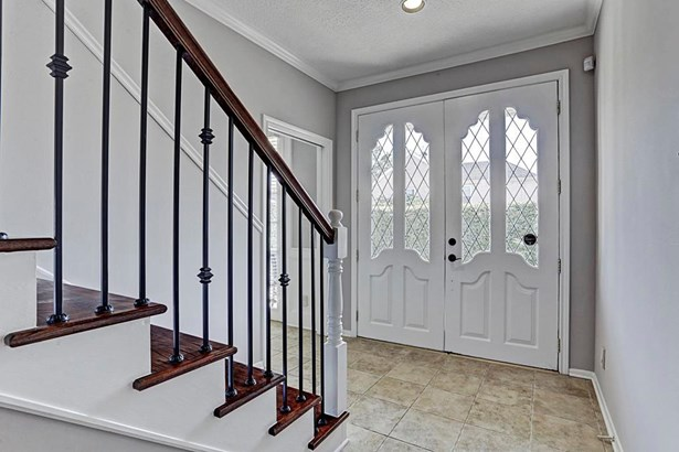 Upon entry you will be greeted by recently updated iron staircase railing and hardwood floors. Home was recently painted (Oct 2017). (photo 4)