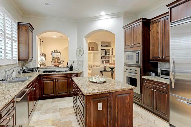 Island Kitchen with wood cabinetry and quality stainless appliances (photo 5)