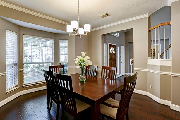 Dining room features hardwood floors, chair rail and crown molding. (photo 3)