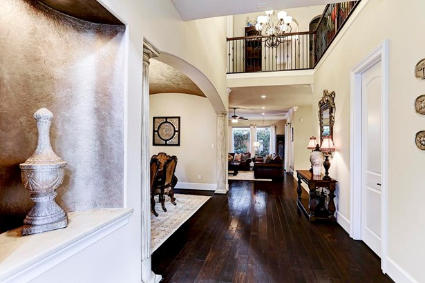 Spectacular entrance in foyer with lovely wood floors and beautiful view of space. (photo 3)