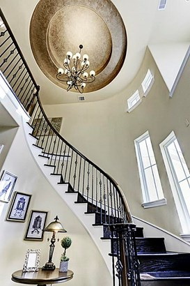 Exquisite sweeping staircase that leads to the luxury master suite and additional bedrooms with ensuite bath. (photo 5)