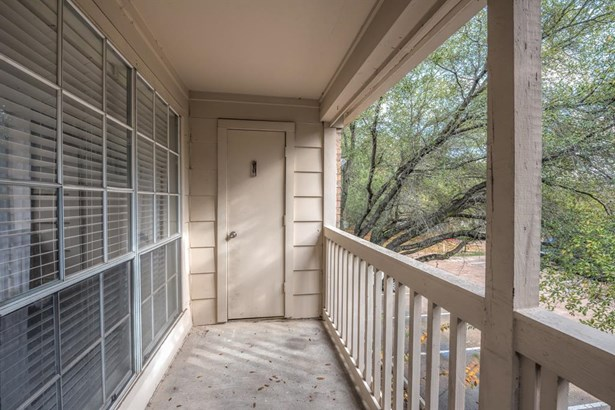 Sizable private balcony provides outdoor space overlooking the grounds below and a private storage closet at the other end. (photo 2)
