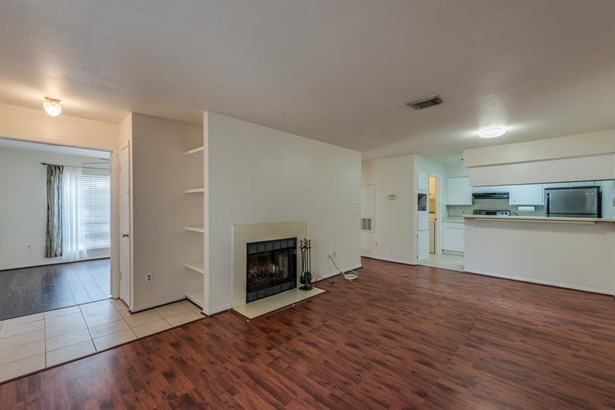 Large living and dining room space with laminate flooring and fireplace allows open flow and easy maintenance! (photo 4)