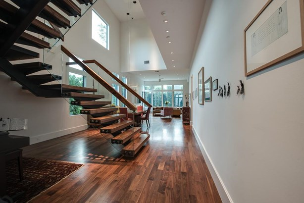 Gorgeous view of the architectural details and near 20-ft. ceiling height while looking into the dining and living rooms beyond. (photo 5)