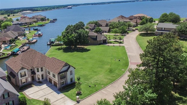 Outstanding waterfront home on Lake Conroe in a private gated community, with gorgeous finishes and custom details that create a luxurious private retreat!