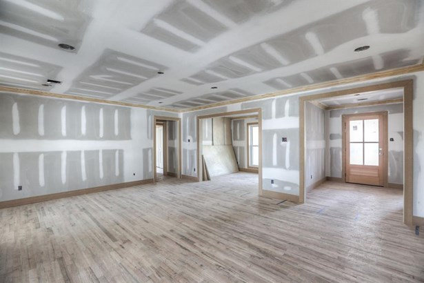Wide entry will be dressed with grass cloth wall paper, sleek flush mount with black and gold accents, divided light front door with Baldwin hardware and wood flooring. Cased opening leads into the large living room with gas fireplace. Recessed lighting a (photo 5)