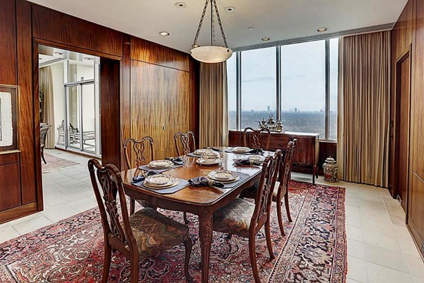 In the main dining room there are built-in linen storage and a silver closet (photo 5)