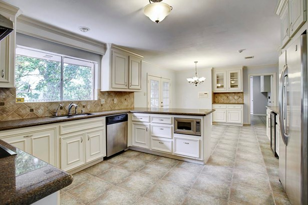 Updated kitchen (13x11) with stainless appliances, granite counters, tumbled marble backsplash, breakfast room (11x11), small butler s pantry, and beverage cooler. Great storage. (photo 5)