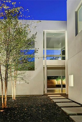 Delicate River Birches enhance the tranquil nature of the path leading to the home s entrance. (photo 2)