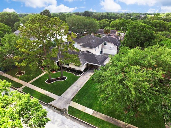 Additional aerial view of beautiful trees surrounding the property. (photo 4)