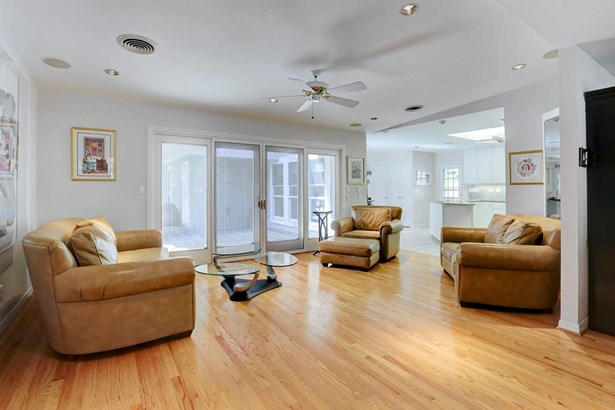 Light and bright living room open to the kitchen with hardwood floors and sliding door access to rear patio and yard.Built-in speakers. (photo 5)