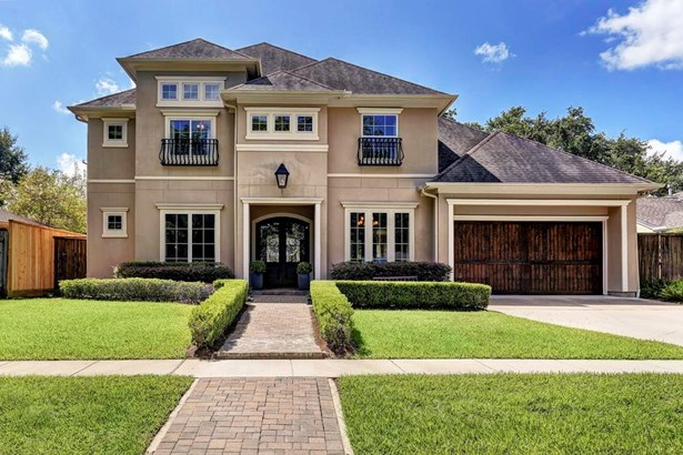 Follow the tree lined street to this beautiful home with 3 car garage. (photo 1)