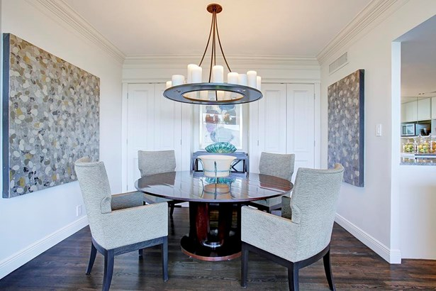 The dining room has refinished chocolate hardwood floors,custom floor to ceiling deep built in cabinets with solid TruStile doors. (photo 5)